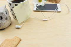 Blank note on cup of coffee and smartphone Stock Photos