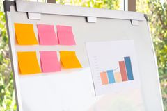 Blank note and data chart for business analysis on the white board. stock photography