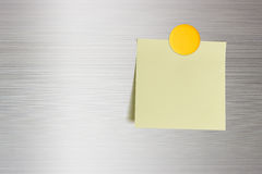 Blank note on a fridge door, copy space for leaving messages. Stock Image
