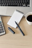Blank Note Pad, Calculator, Computer, Pen on the Table Stock Photography