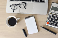 Blank Note Pad, Calculator, Computer, Pen on the Table Royalty Free Stock Photo