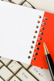 Blank Note Pad and Keyboard Royalty Free Stock Photography