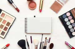 Blank note pad on make up background. Make-up tricks. royalty free stock images