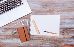 Blank note pad paper with copy space, office desk flat lay. Empty note book with blank space on paper, pencil for writing, grunge office deskt flat lay shot from Royalty Free Stock Images