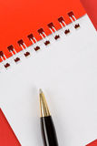 Blank Note Pad and Pen. Red and White Blank Note Pad, Pen Royalty Free Stock Photos