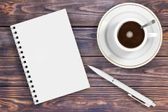 Blank Note Pad with Pen and Cup of Coffee. 3d Rendering. Blank Note Pad with Pen and Cup of Coffee on a wooden table. 3d Rendering Stock Image