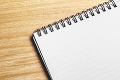 Blank note pad on wood. En table Royalty Free Stock Photos