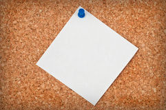 Blank note paper. On cork board background Royalty Free Stock Photo