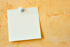 Blank note paper. Single blank note paper attached to a wall Stock Images