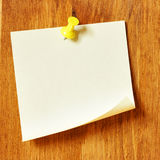 Blank note paper. Single blank note paper attached to a wooden wall royalty free stock images