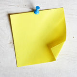 Blank note paper. Single blank note paper attached to a wooden wall royalty free stock image
