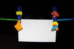 Blank note. Paper clip with bright colors with colored rope Stock Image