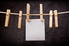 Blank note paper hanging on rope with clothes pins Royalty Free Stock Image