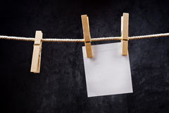 Blank note paper hanging on rope with clothes pins Royalty Free Stock Photos