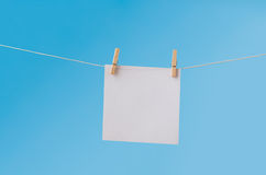 Blank Note Paper Pegged on Clothes Line against Blue Sky Royalty Free Stock Images