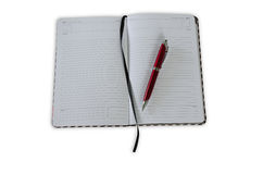 Blank note paper with pen. Isolated on white royalty free stock photos