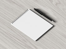 Blank note paper with pen. on wood background Stock Photos