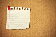 Blank note paper with pin on cork board Stock Photos