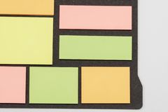 Blank note paper set of different colours forms and sizes. Sticky notes collection on black background.  stock image