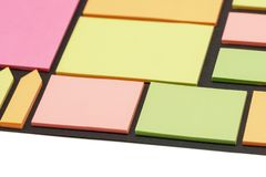 Blank note paper set of different colours forms and sizes. Sticky notes collection on black background.  royalty free stock photo