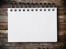 Blank note paper on wood panel Royalty Free Stock Images