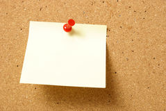 Blank Note. A blank note is pinned to a corkboard Stock Photography