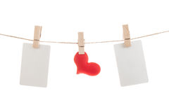 Blank note and red hearts hanging on rope Royalty Free Stock Photo