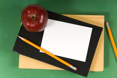 Blank note on school book Royalty Free Stock Images