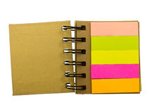 Blank note stickers stuck to spiral notebook Stock Photo