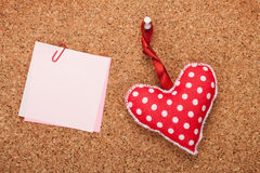 Blank note with toy heart. On wooden cork board Royalty Free Stock Photography