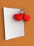 Blank note valentine hearts. Blank white notepaper pinned to a cork board with two small red valentine hearts Stock Images
