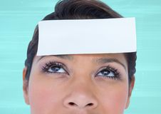 Blank note on a woman forehead Stock Photos