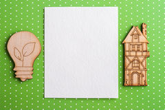 Blank note and wooden lamp and house Stock Photography