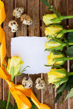 Blank note with yellow roses and quaill eggs Royalty Free Stock Image