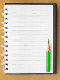 Blank notebook. Blank reporters notebook and pencil on brown paper background Royalty Free Stock Photography