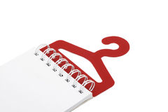 Blank notebook. On a red hanger stock photo