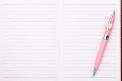 Blank notebook and ballpoint pen. Close up of blank notebook and ballpoint pen Royalty Free Stock Photo