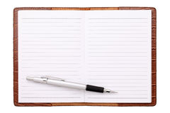 Blank notebook and ballpoint pen. Isolated on white background Stock Photography