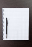 Blank notebook and black pen Royalty Free Stock Images