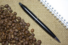 Blank notebook with black pen Royalty Free Stock Photography
