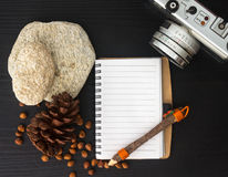 Blank notebook on black wooden table Royalty Free Stock Photos