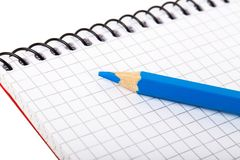 Blank notebook and blue pencil. Close-up blank notebook and blue pencil Royalty Free Stock Photos