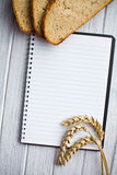 Blank notebook with bread and wheat Royalty Free Stock Images