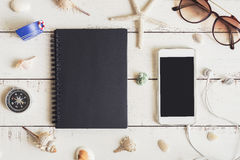 Blank notebook and cellphone with various shell Royalty Free Stock Images