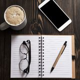 Blank Notebook, Coffee And Phone On A Desk Royalty Free Stock Images