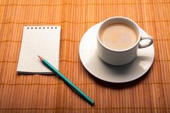 Blank notebook coffee cup on wooden background Royalty Free Stock Photos
