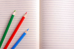 Blank notebook with color pencil. Education concept. Royalty Free Stock Photo