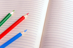 Blank notebook with color pencil. Education concept. Stock Image
