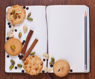 Blank notebook with cookies Royalty Free Stock Photography