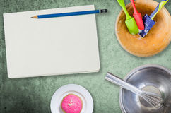 Blank notebook for cooking recipes. With baking equipment Stock Photography